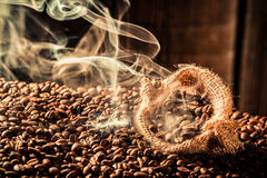 Coffee sack full of aroma roasted grains royalty free stock photos