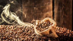 Coffee sack full of fragrance roasted seeds Royalty Free Stock Photography