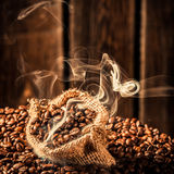 Coffee sack full of fragrance seeds Royalty Free Stock Image
