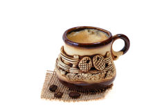 Coffee on sackcloth. Coffee cup and beans served on sackcloth Stock Photos