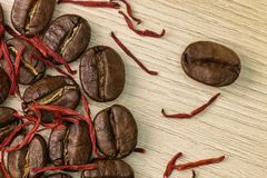 Coffee and saffron. Macro. Wood background Stock Photography