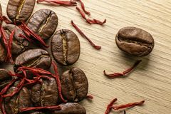 Coffee and saffron. Macro. Wood background Stock Photo
