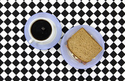 Coffee and sandwich on checkerboard tablecloth Stock Image