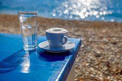 Mourning coffee on the bach. Coffee on the sanny beach stock photography