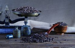 Coffee with scale and coffee beans. Royalty Free Stock Photo