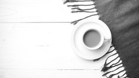 Coffee and scarf background black and white color Stock Image