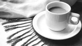 Coffee and scarf background black and white color Royalty Free Stock Photography