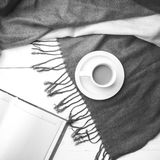 Coffee and scarf background black and white color Royalty Free Stock Photo