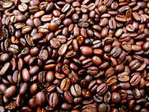 Coffee. Scattered, fried slices of coffee beans Royalty Free Stock Images