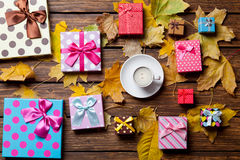 Coffee and season gifts with leafs Stock Photos