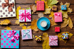 Coffee and season gifts with leafs Stock Images
