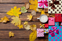 Coffee and season gifts with leafs Royalty Free Stock Image