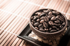 Coffee seed in the wood cup Stock Photography