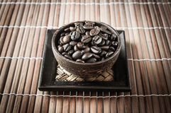 Coffee seed in the wood cup Royalty Free Stock Images