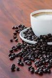 Coffee seed on wood table Stock Photos