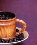 Coffee seed on wood table Stock Image