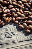Coffee seed on wooden table background no. 4 Royalty Free Stock Image