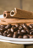 Coffee seeds and cinnamon Stock Photo