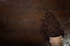 Coffee seeds with some jute bags filled with coffee beans. Jute bags. Low light Stock Images
