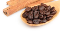 Coffee seeds on wooden spoon Stock Photos