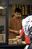 Coffee seller packaging natural coffee grains at old quartier, I Royalty Free Stock Image