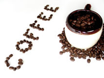 Coffee Series 6. A mug filled with coffee beans, the word coffee spelled out in beans next to it royalty free stock photos
