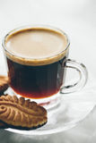 Coffee served with a crunchy biscuit Royalty Free Stock Photography