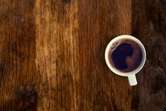 Coffee served on an old wooden table. View from above. Empty space for copying and pasting text. Coffee served on an old wooden table. View from above. Empty royalty free stock photography