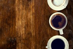 Coffee served on an old wooden table. View from above. Empty space for copying and pasting text. Coffee served on an old wooden table. View from above. Empty royalty free stock images