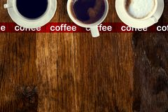 Coffee served on an old wooden table. View from above. Empty space for copying and pasting text. Coffee served on an old wooden table. View from above. Empty royalty free stock photo