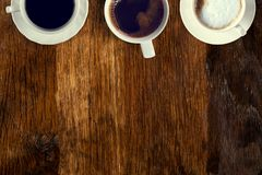 Coffee served on an old wooden table. View from above. Empty space for copying and pasting text. Coffee served on an old wooden table. View from above. Empty royalty free stock image
