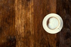 Coffee served on an old wooden table. View from above. Empty space for copying and pasting text. Coffee served on an old wooden table. View from above. Empty stock images