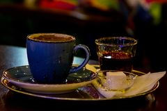Coffee served  with serbet and locum. Turkish traditional coffee served with lokum and sherbet in Turkish famous coffee shop Stock Photo