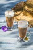 Coffee served in the sunny garden Royalty Free Stock Images