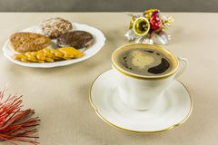 Coffee served in a white cup for Christmas and gingerbread in th Royalty Free Stock Photography