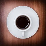Coffee served on white cup, on wooden table. Royalty Free Stock Photos