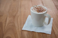 Coffee served in white mug with tissue Royalty Free Stock Photography