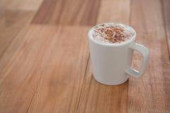 Coffee served in white mug Stock Photo