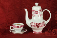 Coffee service. Elegant white and red coffee set against the background of the red tablecloths stock photos