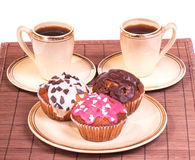 Cups of coffee and muffins on a plate Stock Images