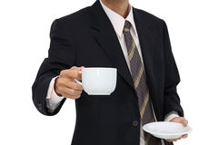 Coffee serving with business man focus at cup Stock Photo