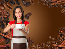 Coffee serving waitress. Young asian barista woman smiling Stock Image