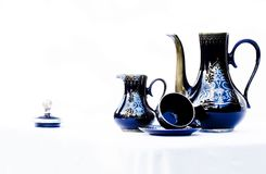 Coffee set in blue porcelain. Coffee, plate and cup of blue porcelain coffee with filigrees in silver Royalty Free Stock Photo
