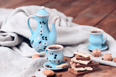 Coffee set with chocolate bars. Almond chocolate bars with cups of coffee, selective focus Royalty Free Stock Image