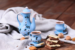 Coffee set with chocolate bars. Almond chocolate bars with cups of coffee, selective focus Royalty Free Stock Photo