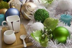 Coffee set with Christmas balls Royalty Free Stock Image