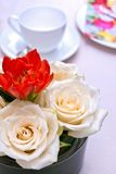 Coffee set with flower arrangement Royalty Free Stock Images