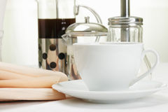 Coffee set and paper. Coffee set with various food and paper on white tablecloth Royalty Free Stock Photos