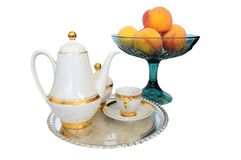 Coffee set on silver tray and bowl of appricots Royalty Free Stock Image
