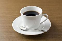 Coffee set on the wooden table. Coffee set. Cup, saucer and spoon Royalty Free Stock Images